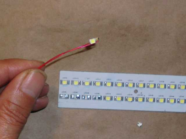 A surface mount LED was harvested from a surplus lighting strip.  I soldered on a tiny 100-ohm surface mount resistor for current limiting.