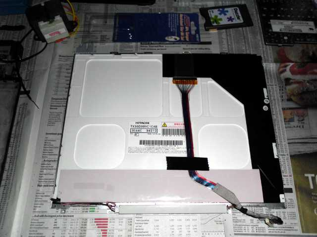The LCD panel after removing it from the laptop.  Wasn't easy.